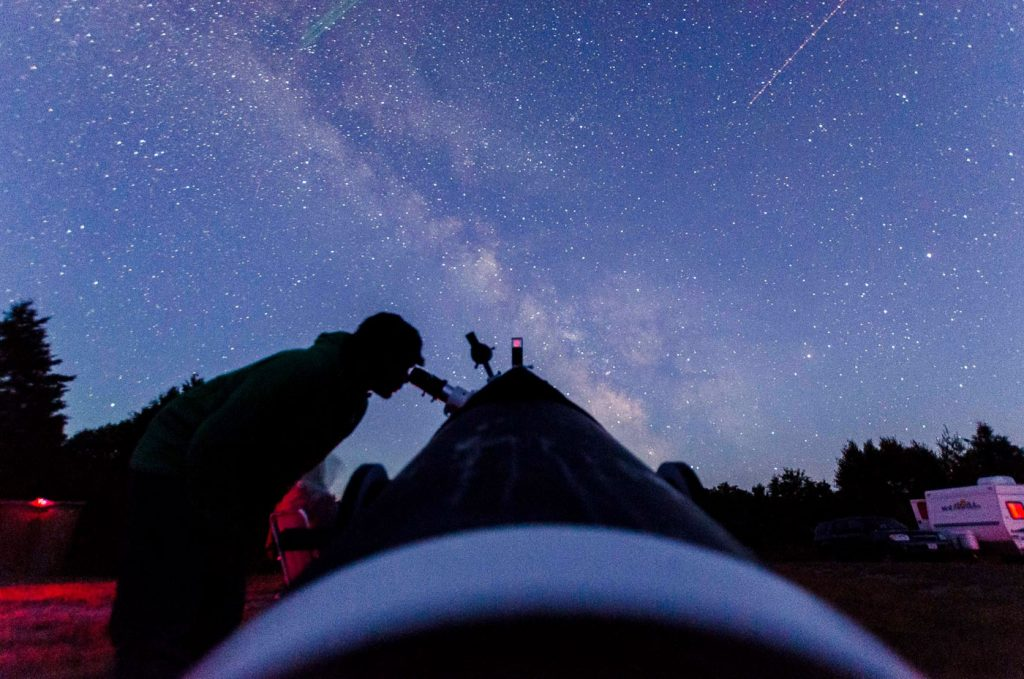 Silhouette of a man observing the sky with a telescope. Taken at Manitoulin Eco Park   Gordon's Park. PC: Gordon's Park