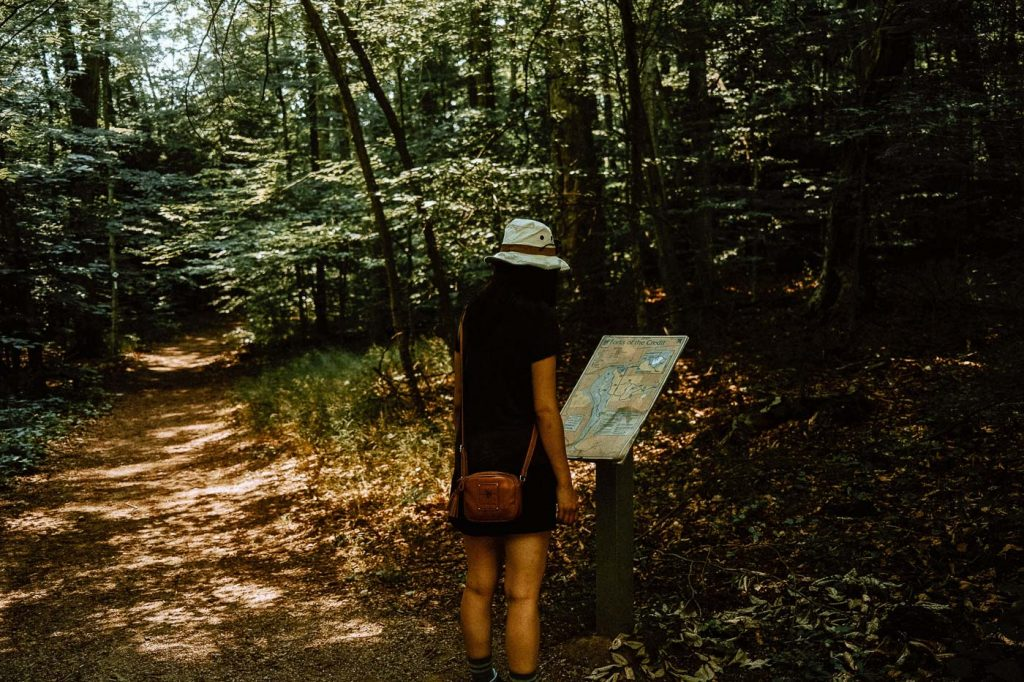 Woman looking at signage at Forks of the Credit Provincial Park