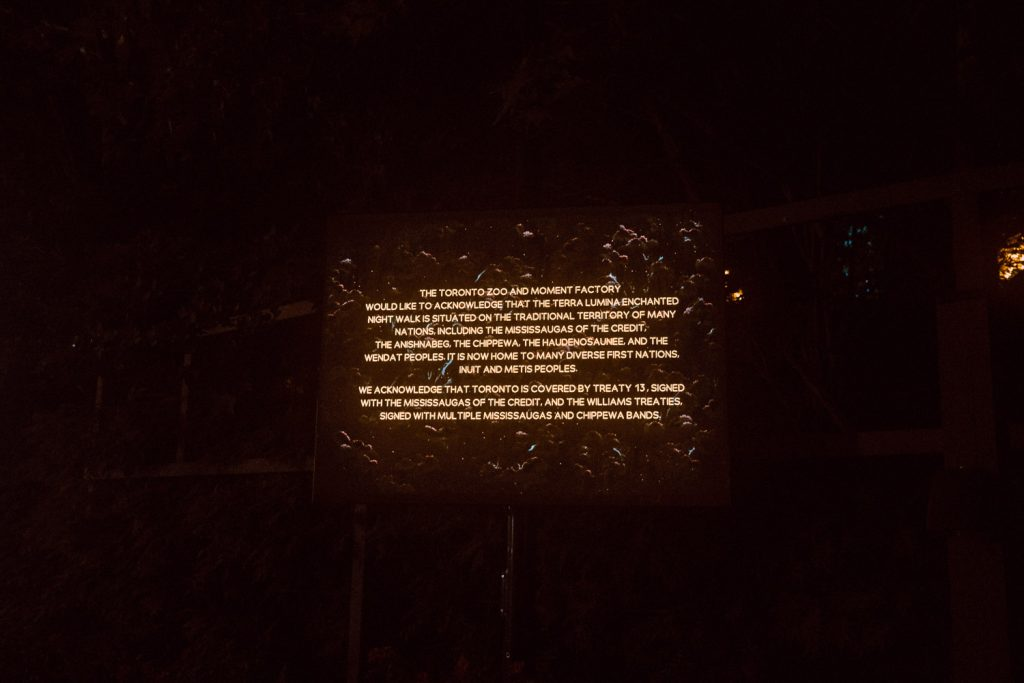 Terra Lumina information sign acknowledge and crediting Indigenous artists and creative collaborators at the Terra Lumina event at the Toronto Zoo