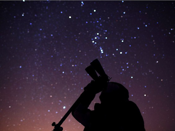 Man with telescope point up towards thee night sky taken at Point Pelee National Park. PC: PHOTO BY DAX MELMER /Windsor Star