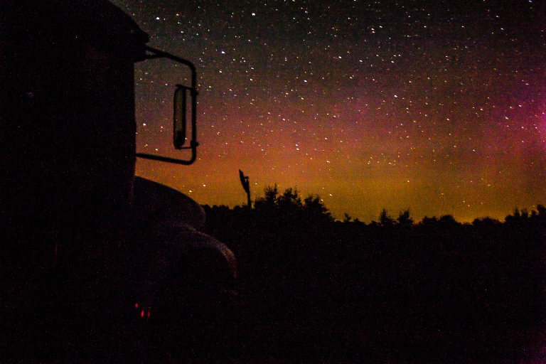 Silhouette of a Bus in the foreground with the night sky as the background. Taken at Irvine Lake Airstrip PC: We Got Schooled