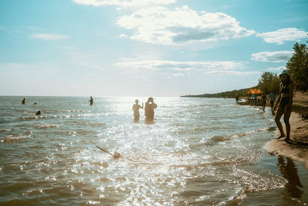 Sunny picture of Lake Erie at Long Point Provincial Park's Dog Beach. In the image, you can see that the lake is very shallow for several meters in and is easily accessible for wading.