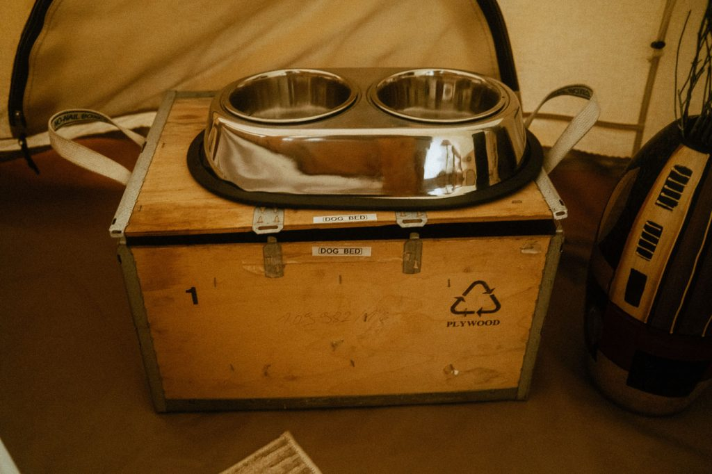 Interior of Sibo's Bell Tent in Verona, Ontario also comes with dog accessories like a dog water bowl and food bowl, and a dog bed