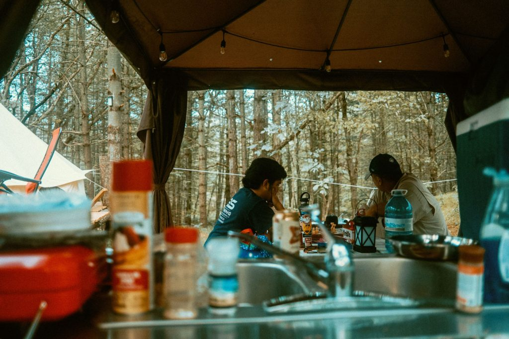 View from the kitchen sink area of the sheltered picnic area at Sibo's Bell Tent Glamping in Verona, Ontario