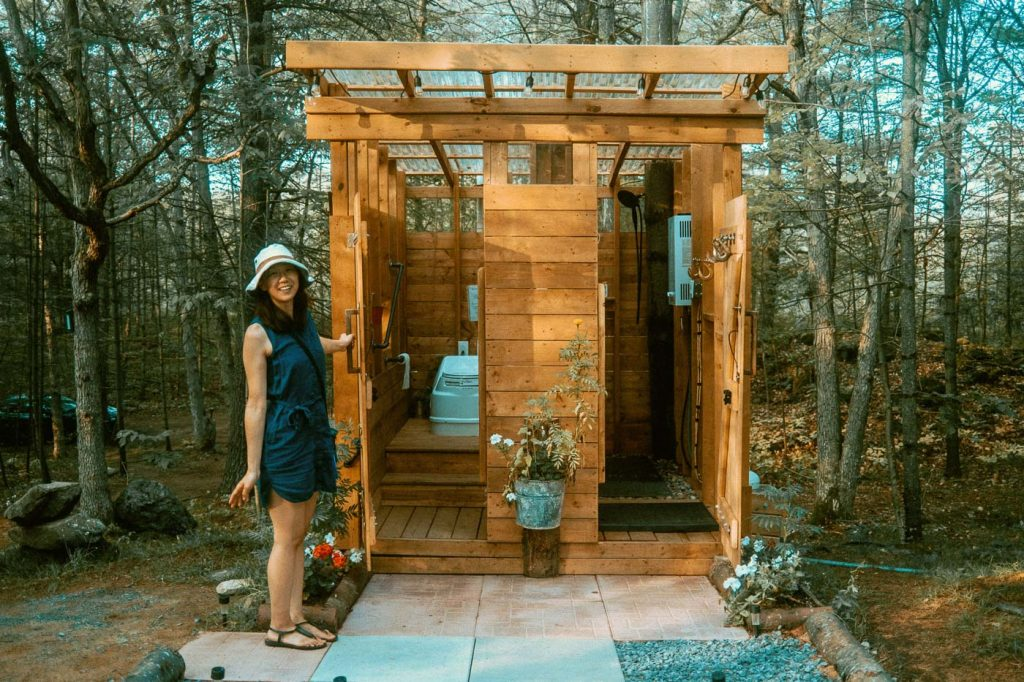 Standalone cabin for the washroom and shower at Sibo's Bell Tent Glamping site in Verona, Ontario