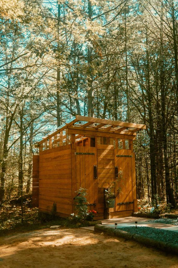 Side profile of shower and washroom cabin at Sibo's Bell Tent GlampingSite