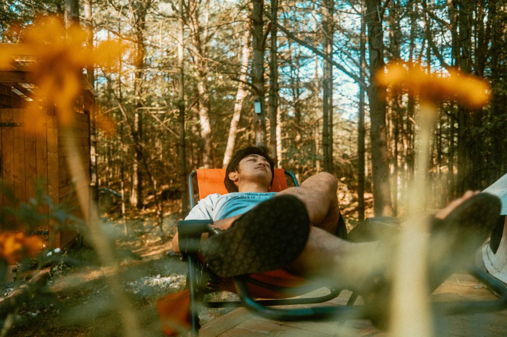 Relaxing on a lawn chair on Sibo's Bell Tent Glamping Site in Verona, Ontario