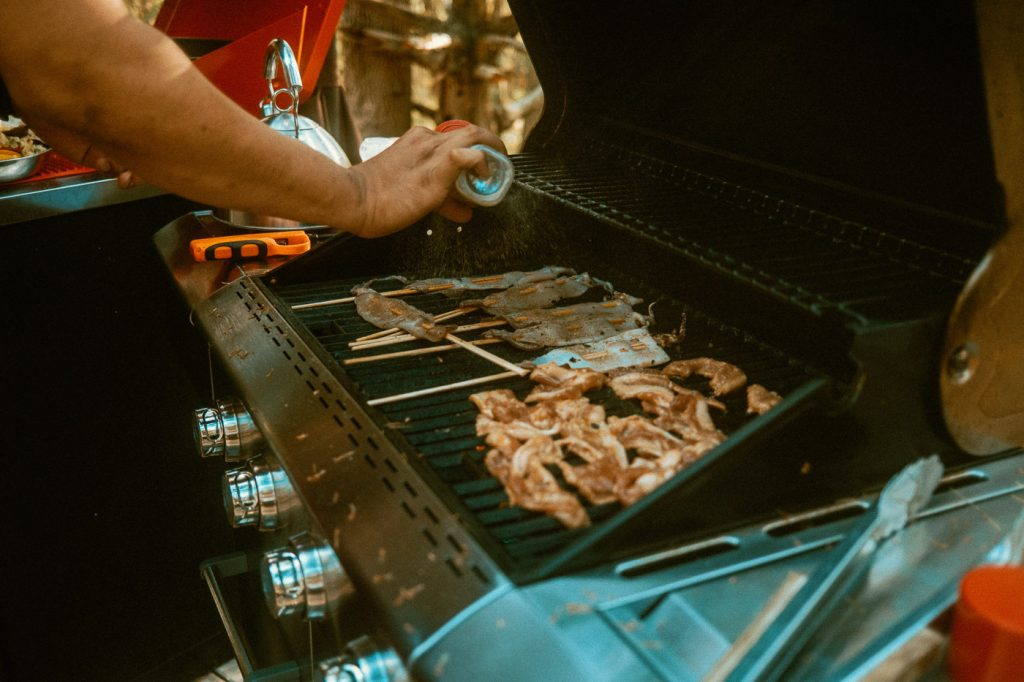 Grilling Squid and Pork Belly on the BBQ at Sibo's Bell Tent Glamping Site