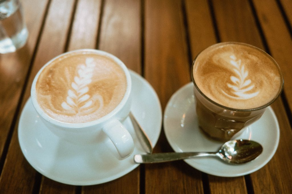 Cappuccino and Cortado on a wooden table at Mildred's Temple Kitchen