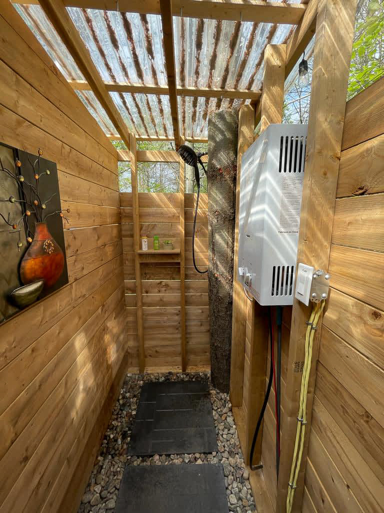 Outdoor shower at Sibo's Bell Tent Glamping in Verona Ontario